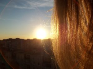 Mop of hair and sunset