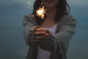 A woman with sparkler.