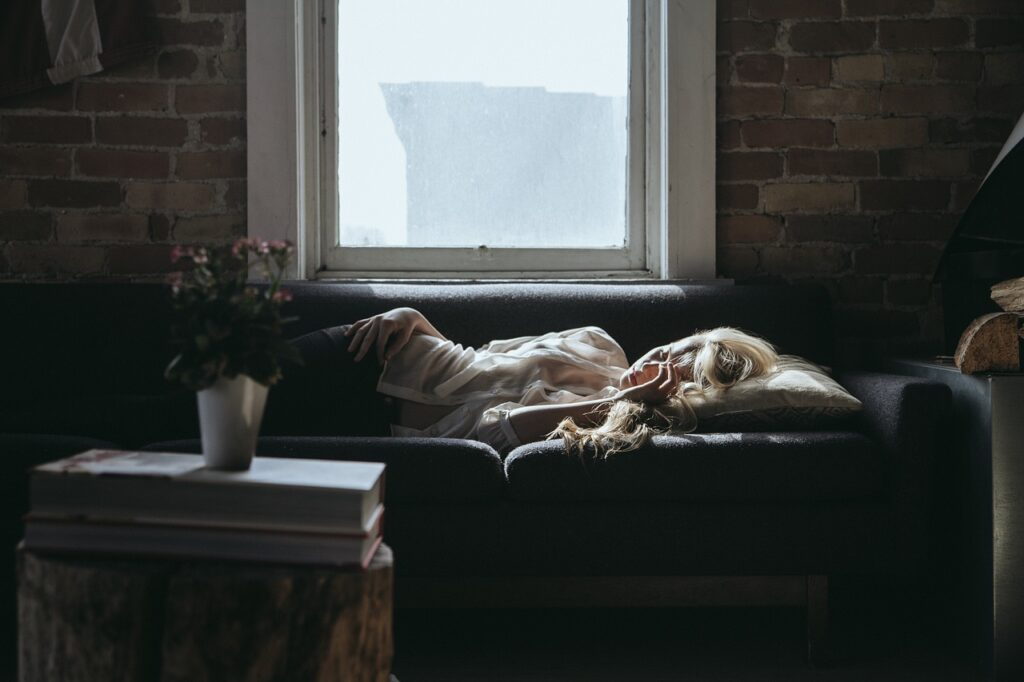 Woman in settee during daytime.