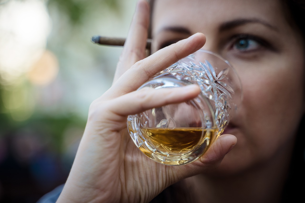 Woman is drinking whiskey