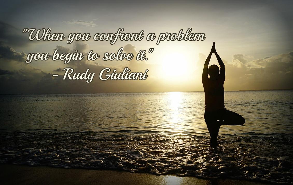 Woman makes yoga on the beach.
